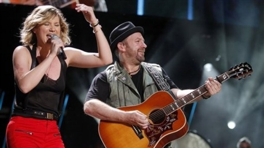 June 10: Jennifer Nettles, left, and Christian Bush of Sugarland perform during the CMA Fan Festival. (AP)