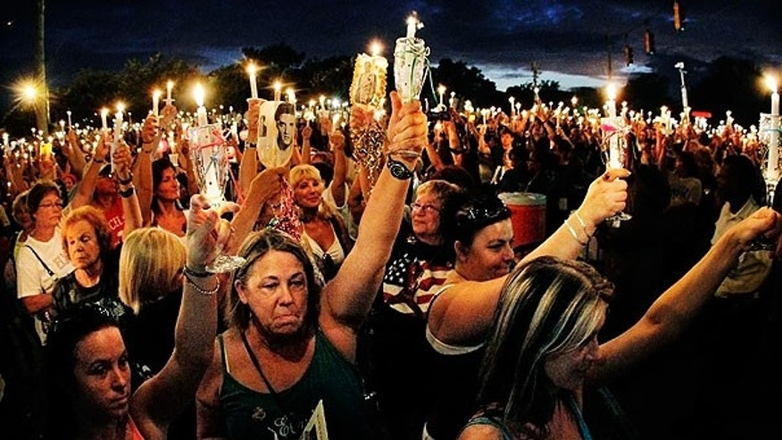 Aug. 15: Elvis fans from all over the world gather at the gates of Graceland for a candlelight vigil marking the 34th anniversary of the death of Elvis Presley in Memphis, Tenn.