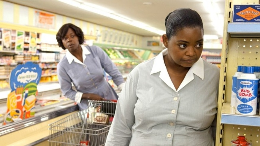 "In this film publicity image released by Disney, Octavia Spencer, right, and Viola Davis are shown in a scene from ""The Help.""  (AP Photo/Disney, Dale Robinette)"