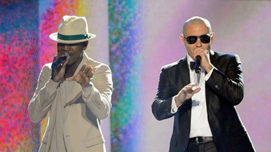 May 22, 2011: Singer Ne-Yo and rapper Pitbull perform onstage during the 2011 Billboard Music Awards at the MGM Grand Garden Arena in Las Vegas, Nev.