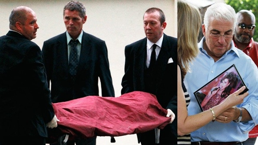 Amy Winehouse's body is removed from her north London home Saturday (left) on Saturday July 23, 2011. Her father talks with mourners outside her home Monday (right) on Monday July 25.