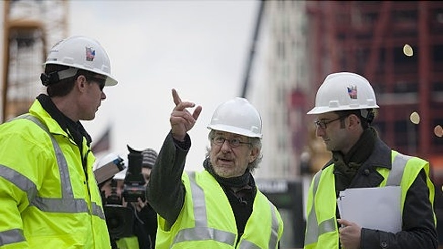 Executive producer Steven Spielberg (center) tours the project while filming documentary 'Rising: Rebuilding Ground Zero.' (Shaul Schwarz/Getty)
