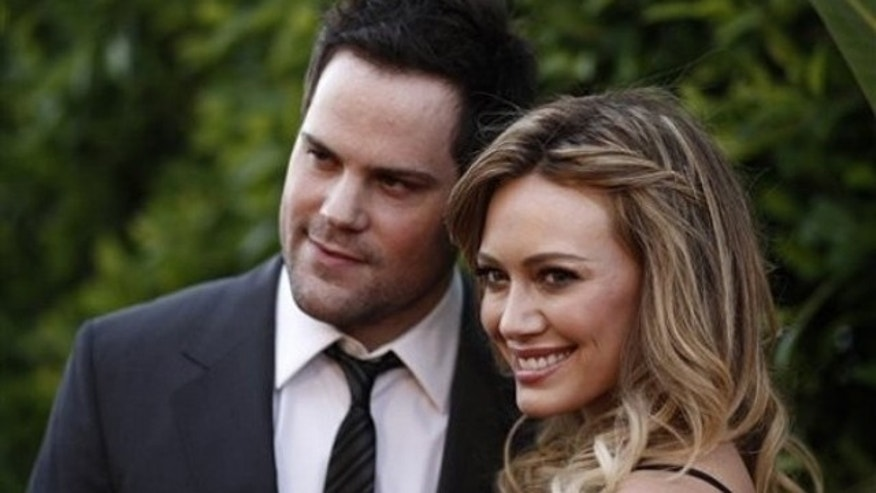 Hilary Duff, right, and Mike Comrie in May of 2011 (AP)