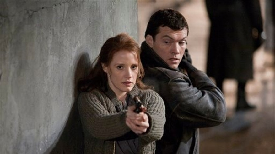 "In this film image released by Focus Features, Jessica Chastain, left, and Sam Worthington are shown in a scene from the espionage thriller ""The Debt."" (AP)"