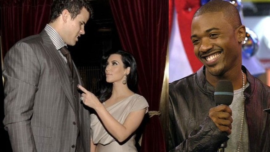 Kris Humphries (left) had an awkward moment when he was forced to sit next to his wife Kim Kardashian's ex-boyfriend and sex tape partner (AP)