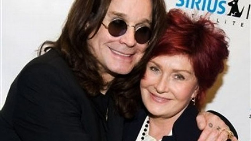 Ozzy Osbourne (shown here with wife Sharon) is a new columnist for Rolling Stone magazine.