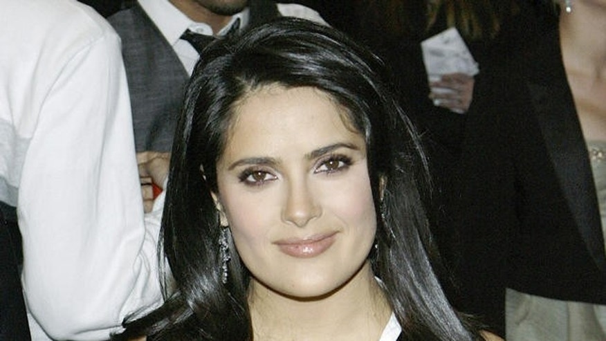 Actor Salma Hayek arrives at the Metropolitan Museum of Art Costume Institute Gala in New York, Monday, May, 7, 2007. ( AP Photo/Stuart Ramson)