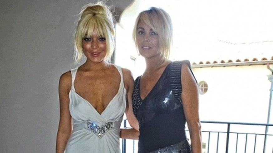 Lindsay's mom Dina looked more natural than her 26-year-old daughter at Kim Kardashian's wedding. (Celebuzz)
