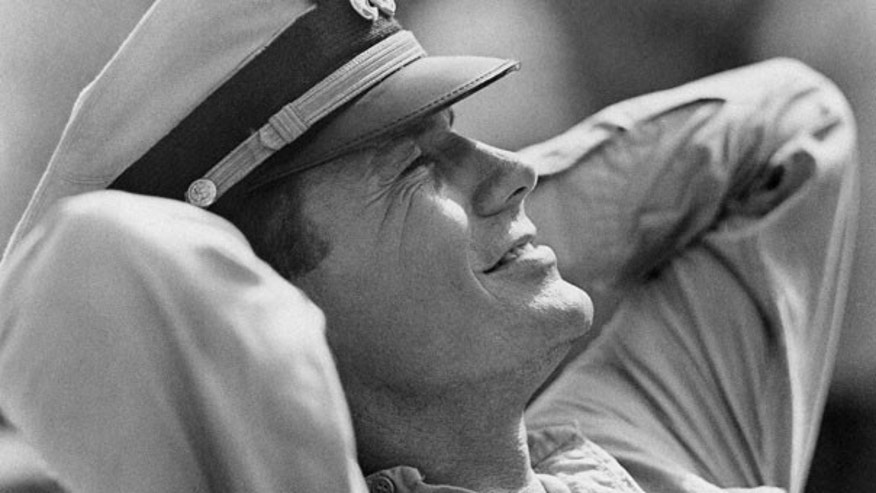 "In this Feb. 25, 1963 file photo, actor Cliff Robertson takes a break as the skipper of the PT 109, Lt. John F. Kennedy in the movie ""PT 109."""