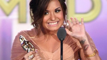 SANTA MONICA, CA - SEPTEMBER 10:  Actress Demi Lovato accepts the award for Favorite TV Actress  - Leading Role in a Comedy during the 2011 NCLR ALMA Awards pre-show held at Santa Monica Civic Auditorium on September 10, 2011 in Santa Monica, California.  (Photo by Jesse Grant/Getty Images for NCLR)
