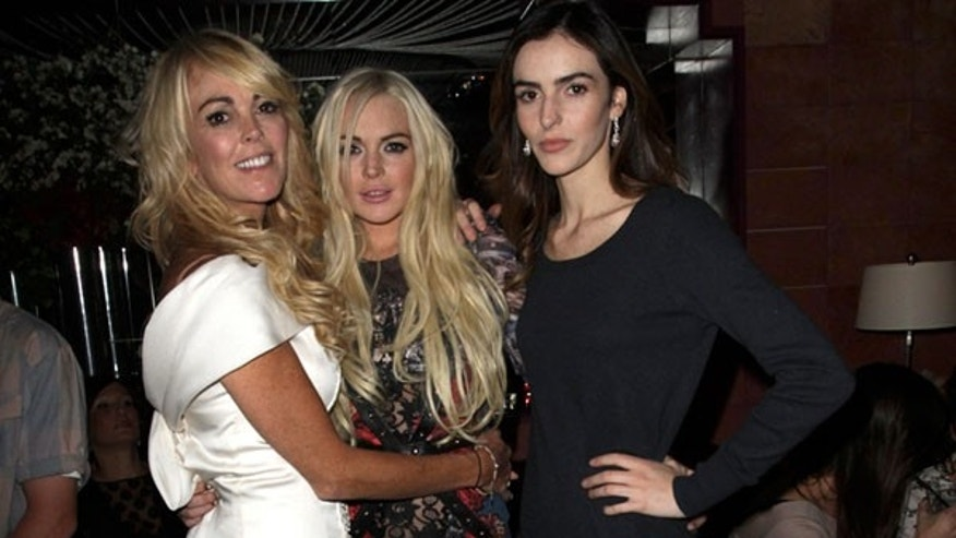 Dina, Lindsay and Ali Lohan hang out in a VIP club. At another venue, bystanders say Lohan threw a glass at a photographer trying to snap a pic (Rumor Fix)