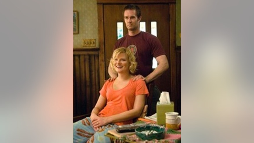 RAISING HOPE:  Jimmy Chance is a well-meaning screw-up trying his best to raise his infant daughter with the help of the eccentric family who did a less-than-stellar job raising him in RAISING HOPE premiering this fall on FOX.    Pictured: Pictured L-R: Marhta Plimpton and Garret Dilahunt. ©2010 Fox Broadcasting Co. Cr: Randy Tepper/FOX