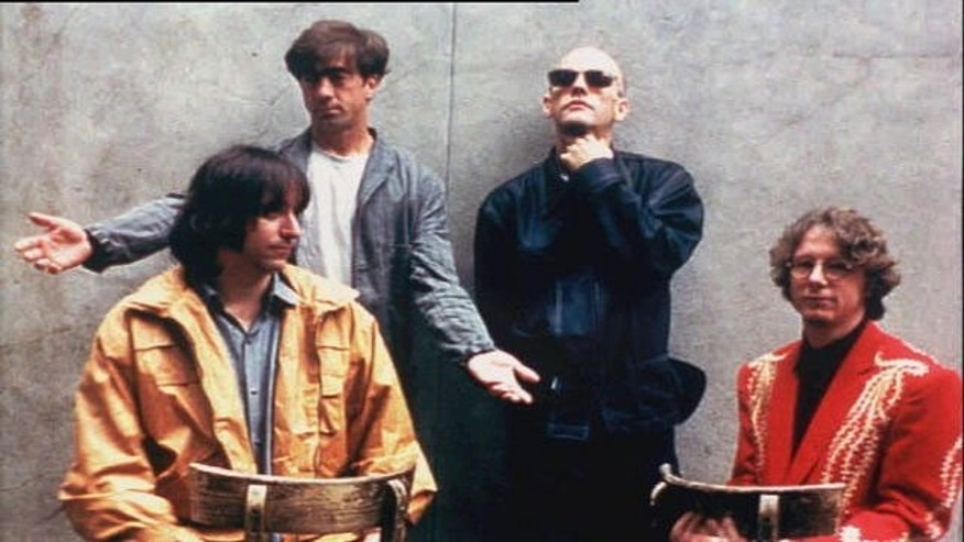 R.E.M.: (l-r) Peter Buck, Bill Berry, Michael Stipe, and Mike Mills (AP)