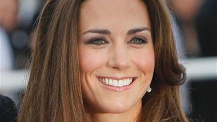 Kate, Duchess of Cambridge, wife of Prince William, arrives at a charity event for Absolute Return for Kids, ARK, in central London, Thursday, June, 9, 2011. The charity event is the first official engagement for the couple since they were married on April 29.(AP Photo/Alastair Grant)