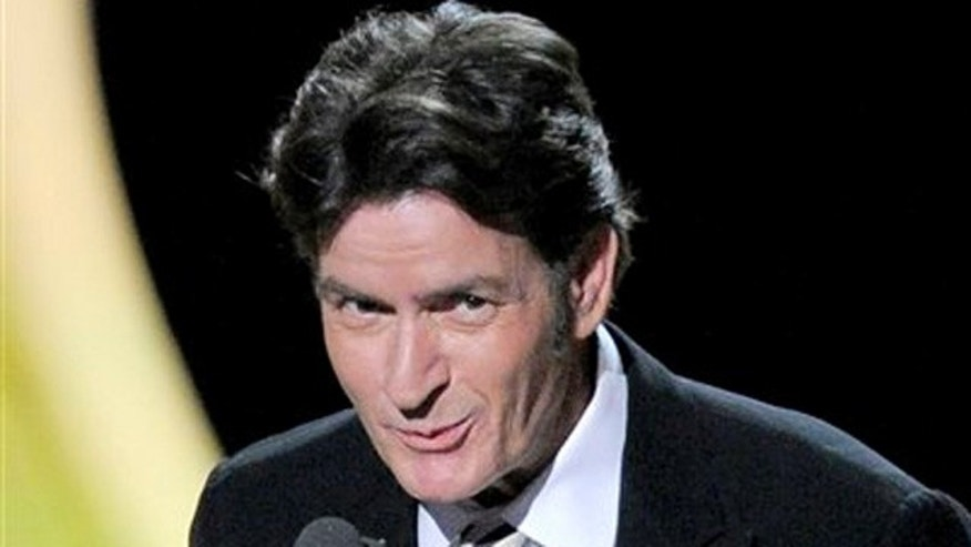 Sept. 18, 2011: Charlie Sheen presents the award for  outstanding lead actor in a comedy series at the 63rd Primetime Emmy Awards.