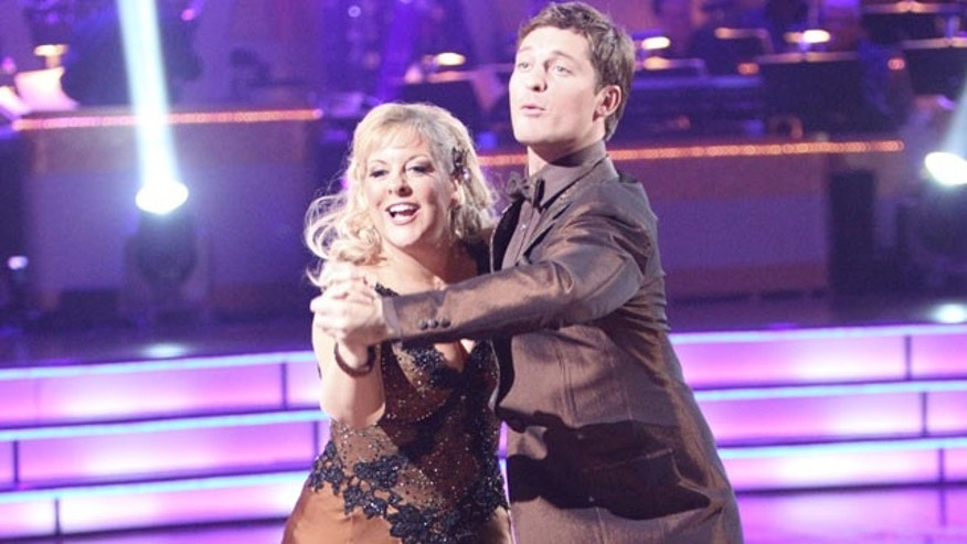 "In this image released by ABC, Nancy Grace, left, and her partner Tristan Macmanus perform on the celebrity dance competition series, ""Dancing with the Stars."" (AP)"