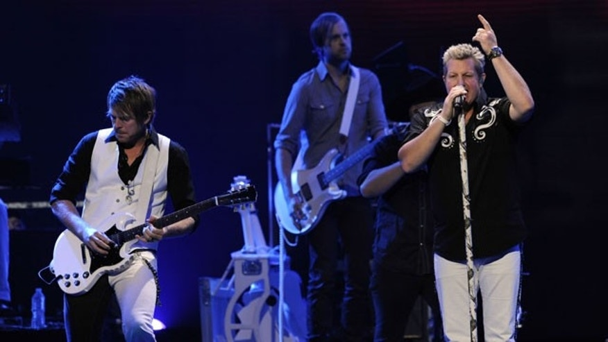 September 24: Gary LeVox, right, and Joe Don Rooney, left, of the band Rascal Flatts perform during the iHeartRadio music festival in Las Vegas.