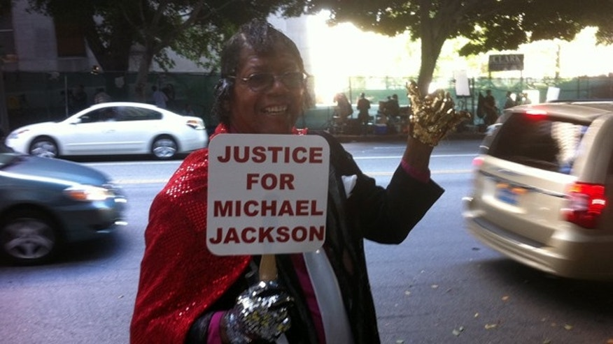 A Michael Jackson supporter stands outside the courthouse in Los Angeles, California Friday, September 30, 2011.