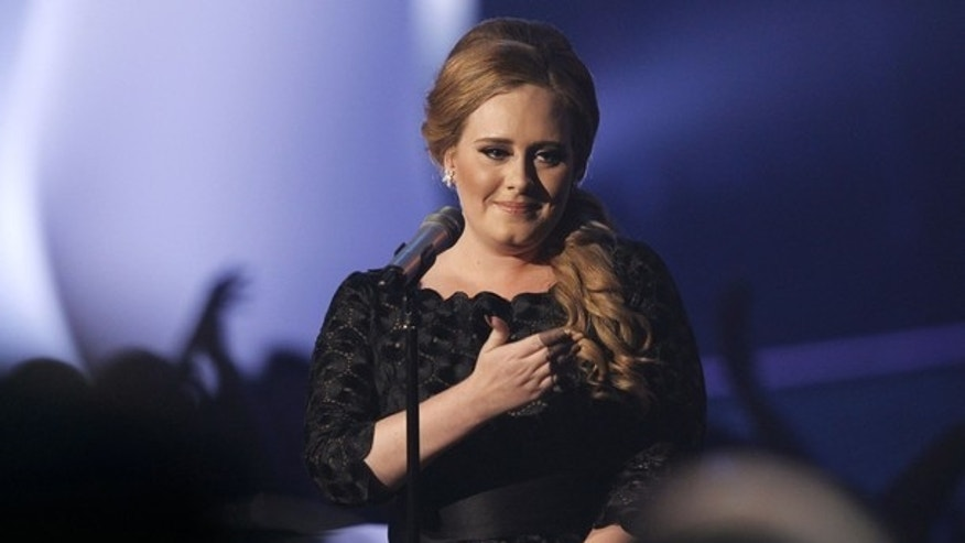 "Aug. 28: British singer Adele performs ""Someone Like You"" at the 2011 MTV Video Music Awards in Los Angeles. (Reuters)"