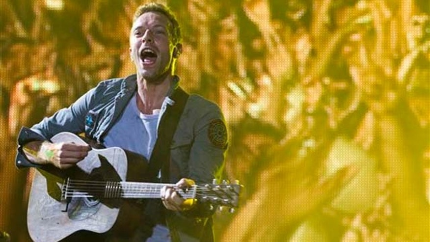 In this Oct. 2, 2011 file photo, Chris Martin of the English alternative rock band Coldplay performs during the Rock in Rio music festival in Rio de Janeiro, Brazil.