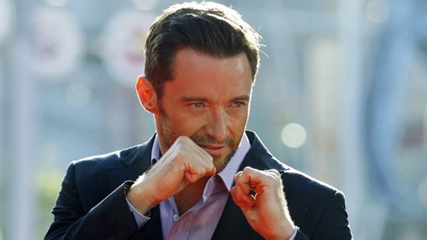 "Cast member Hugh Jackman poses at the movie premiere of ""Real Steel"" in Los Angeles October 2, 2011. REUTERS/Danny Moloshok (UNITED STATES - Tags: ENTERTAINMENT)"