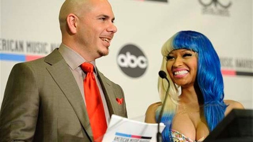Oct. 11, 2011: Pitbull and Nicky Minaj announce nominations for the 2011 American Music Awards on Tuesday  in Los Angeles. The awards will be held in Los Angeles on November 20.