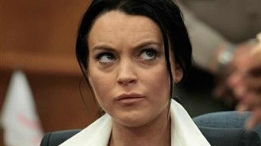 May 24: Lindsay Lohan sits in the courtroom during her hearing in Beverly Hills.