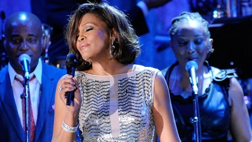 In this Feb. 13, 2011 file photo, singer Whitney Houston performs at the pre-Grammy gala & salute to industry icons with Clive Davis honoring David Geffen in Beverly Hills, Calif. The singer's rep confirms she just entered rehab. (AP)