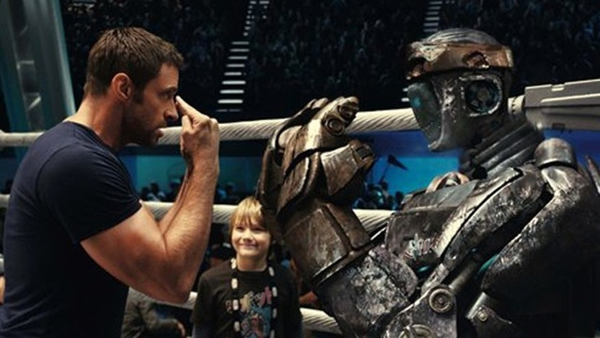 "This file image provided by Disney/DreamWorks II shows Hugh Jackman, left, and Dakota Goyo in a scene from ""Real Steel."""