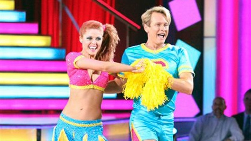 "In this Oct. 17, 2011 photo, TV personality and fashion expert Carson Kressley, right, and his partner Anna Trebunskaya perform in the celebrity dance competition series ""Dancing with the Stars,"" in Los Angeles."