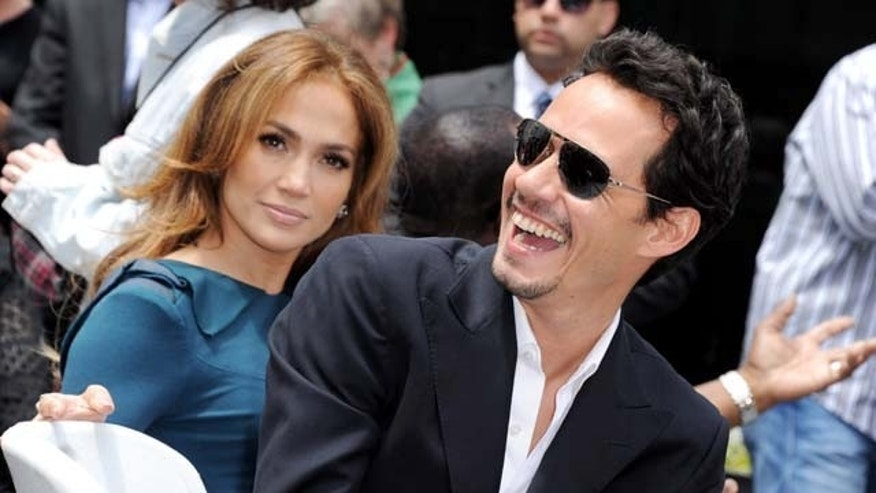 MAY 23, 2011: Jennifer Lopez and her husband singer Mark Anthony pose at Simon Fuller's Hollywood Walk of Fame star presentation ceremony at Hollywood & Vine in Los Angeles, Calif.