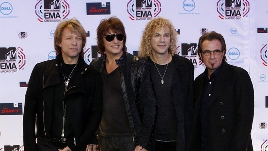 Members of the rock band Bon Jovi Jon Bon Jovi, Richie Sambora, David Bryan and Tico Torres (L-R) pose for photographers as they arrive for the MTV Europe Music Awards 2010 in Madrid, in this file picture taken November 7, 2010. (Reuters)