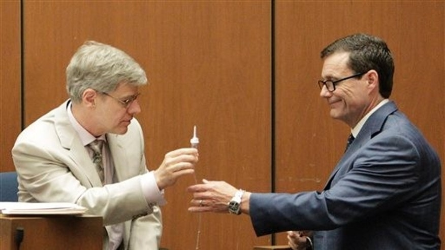 Oct. 21, 2011: Ed Chernoff, right, a defense attorney for Dr. Conrad Murray, cross examines anesthesiology expert Dr. Steven Shafer, during Murray's involuntary manslaughter trial in Los Angeles.