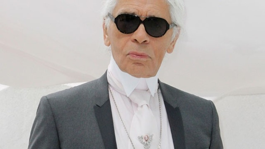 FILE - This Oct.4, 2011 file photo shows German fashion designer Karl Lagerfeld posing before Chanel's spring-summer 2012 ready to wear collection in Paris.