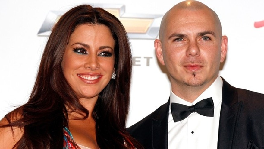 May 22, 2011:Model Nayer and Pitbull pose in the press room during the 2011 Billboard Music Awards at the MGM Grand Garden Arena in Las Vegas, Nev.