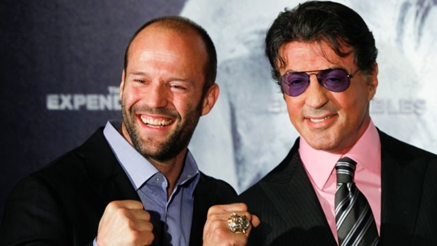 'The Expendables' castmates Jason Statham and Sylvester Stallone at the Berlin premiere of the film in 2010. A stuntman died and a second has been hospitalized while filming the sequel to the film in Bulgaria.