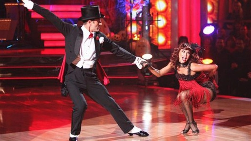 "In this Oct. 31, 2011 image released by ABC, David Arquette, left, and his partner Kym Johnson perform on the dancing competition series ""Dancing with the Stars,"" in Los Angeles."