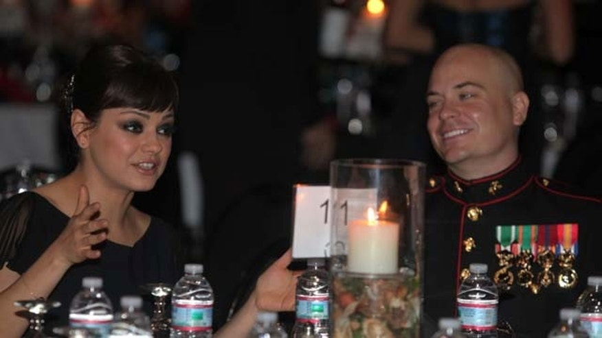 Sgt. Scott Moore and his guest, actress Mila Kunis attend the 236th Marine Corps birthday ball for 3rd Battalion, 2nd Marine Regiment, 2nd Marine Division in Greenville, N.C., Nov. 18, 2011.