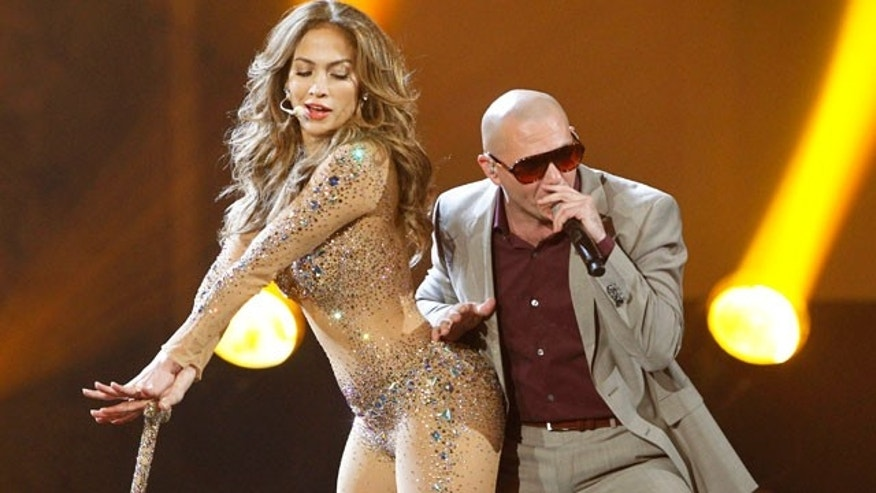 JLo and Pitbull perform at the 2011 American Music Awards.