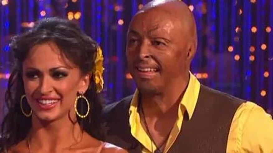 "Nov. 21, 2011: J.R. Martinez and dance partner Karina Smirnoff dance to jennifer Lopez's  ""Let's Get Loud"" during the finals for Dancing With the Stars Monday night in Los Angeles, Calif."