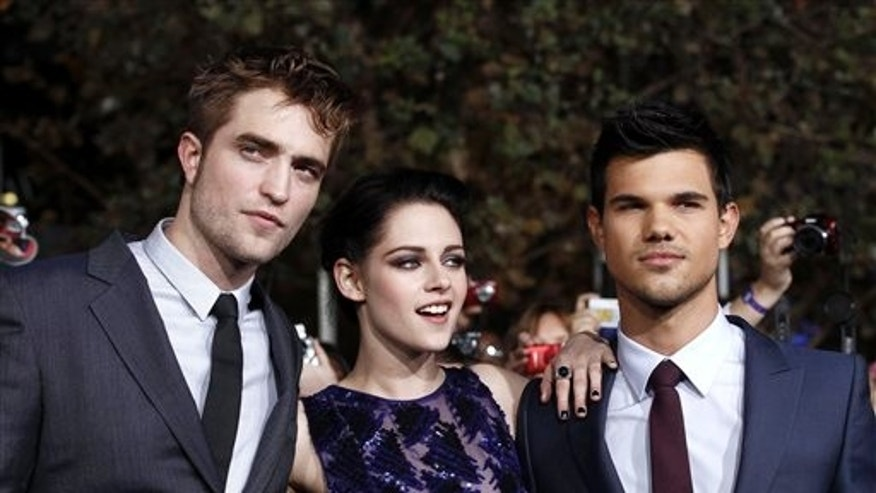 "Nov. 14. 2011: Robert Pattinson, left, Kristen Stewart, center, and Taylor Lautner arrive at the world premiere of ""The Twilight Saga: Breaking Dawn - Part 1,"" in Los Angeles."