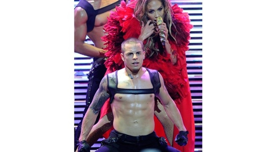Sept. 24, 2011: Singer/actress Jennifer Lopez performs with dancer Casper Smart at the iHeartRadio Music Festival at the MGM Grand Garden Arena  in Las Vegas, Nev.