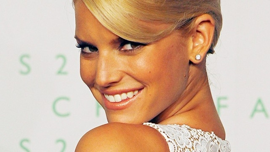 June 5, 2006: Singer and actress Jessica Simpson poses for photographers on the red carpet of the 2006 CFDA Fashion Awards in New York City.