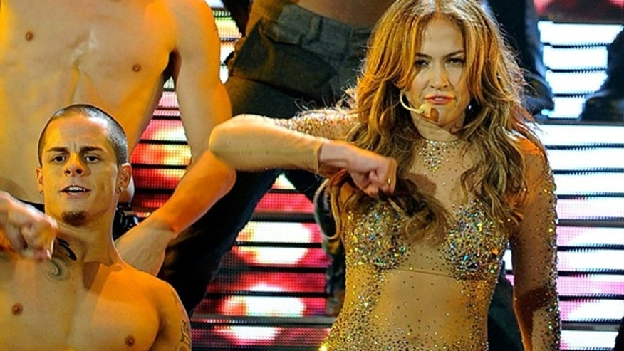 Nov. 20, 2011: Singer Jennifer Lopez performs onstage with dancer Casper Smart at the 2011 American Music Awards held at Nokia Theatre L.A. LIVE in Los Angeles, Calif.