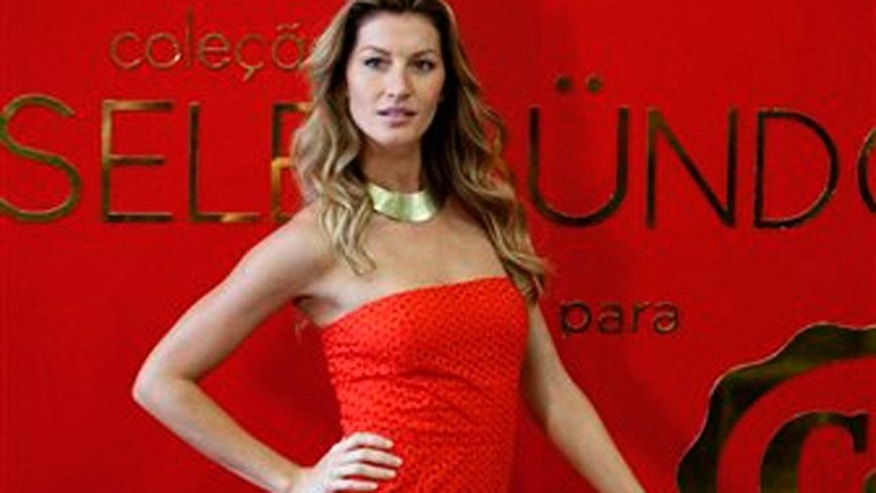 Dec. 1, 2011: Brazilian top model Gisele Bündchen poses for pictures as she wears a design by C&A from a collection with her name at a promotional event in Sao Paulo, Brazil on Thursday.