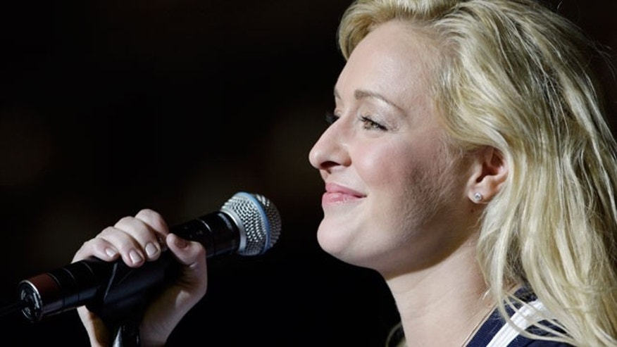 In this undated file photo, country singer Mindy McCready performs in Nashville, Tenn. A missing persons report has been filed for McCready and her 5-year-old son Zander. (AP)