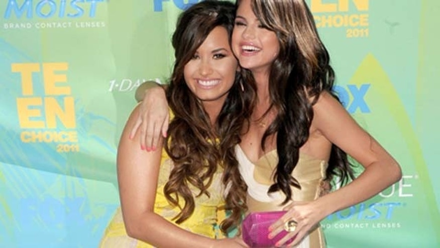 August 07, 2011: Actresses/singers Demi Lovato and Selena Gomez arrive at the 2011 Teen Choice Awards held at the Gibson Amphitheatre in Universal City, Calif.