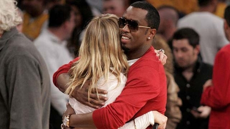 LOS ANGELES, CA - MAY 29:  Cameron Diaz (L) and Sean 'P. Diddy' Combs (R) hug at the Los Angeles Lakers vs San Antonio Spurs Western Conference Game 5 at the Staples Center on May 29, 2008 in Los Angeles, California.  (Photo by Noel Vasquez/Getty Images)