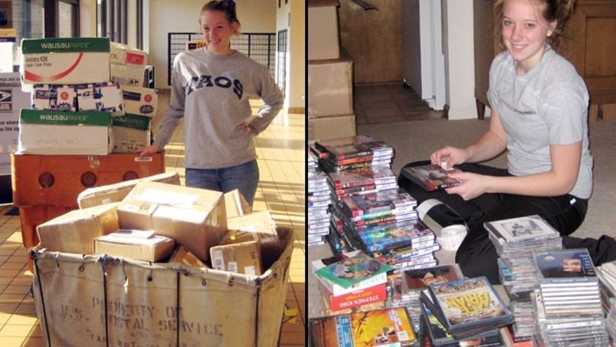 Kaylee Marie Radzyminski, then 15 and a sophomore in high school, is pictured preparing to send packages of CDs and DVDs overseas on behalf of Tunes 4 the Troops, the nonprofit she founded in 2005.