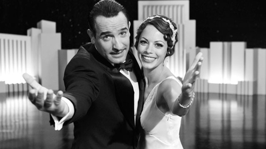 "In this film publicity image released by The Weinstein Company, Jean Dujardin portrays George Valentin, left, and Berenice Bejo portrays Peppy Miller in a scene from ""The Artist."" (AP)"